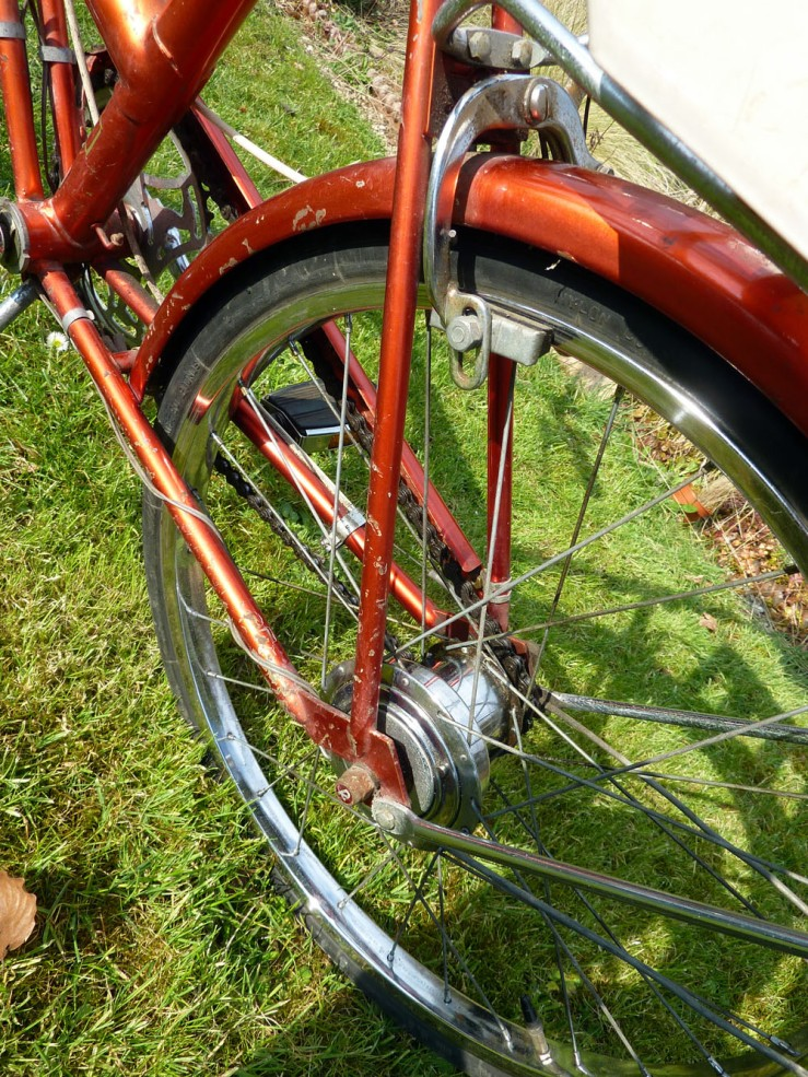 The rear hub seen from the left-hand side of the bike. The wider section of the hub houses the alternator. The hub gear was operated by a twist-grip on the handlebar. This had a friction clutch within it to automatically take up  slack that might develop in the gear control cable. There are instructions for re-setting this function elsewhere on this website.