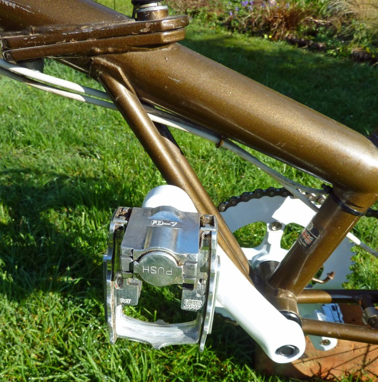 Another view of the folded pedal, with the frame hinge at top left.